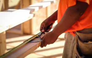 A tradesman working on a Oswald Company project.